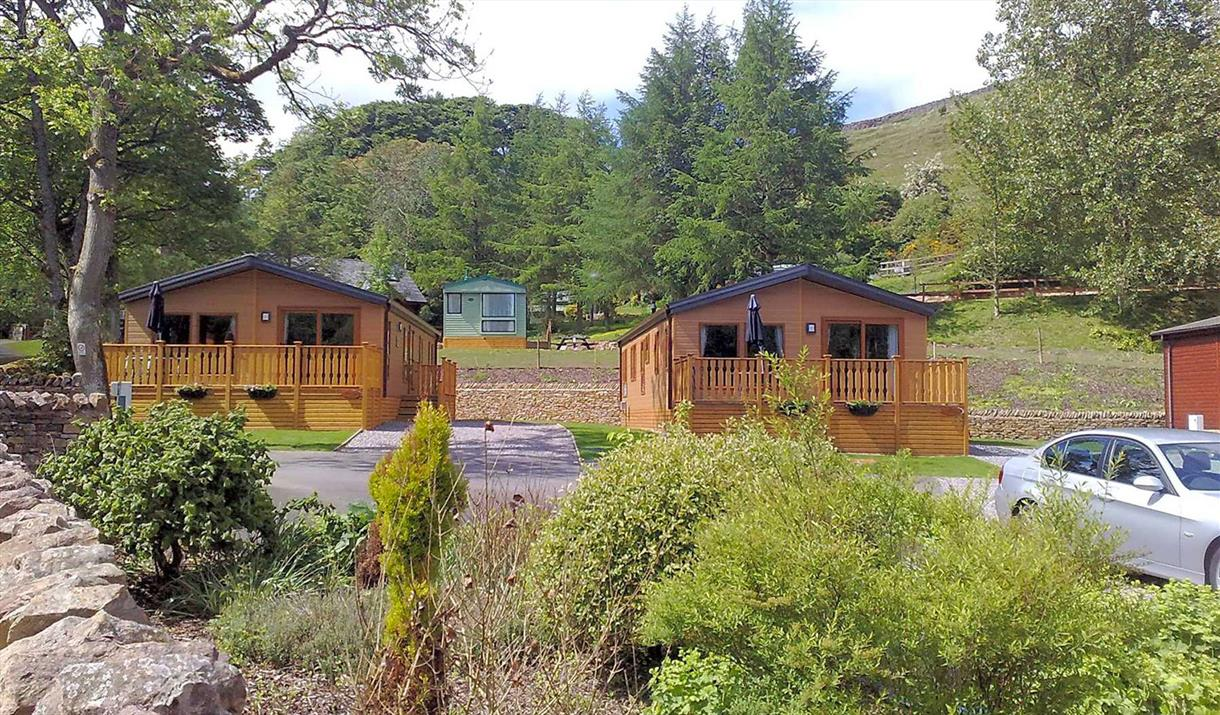 Our lodges: Sycamore View (left) and Hazel Cottage (right)